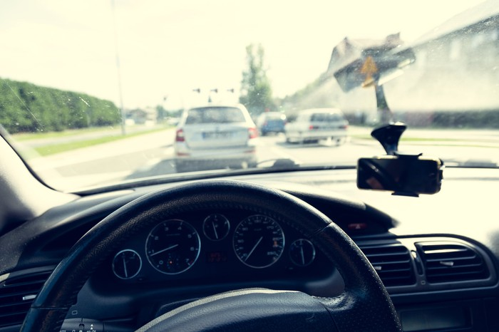A highway as seen from the driver's seat in a car.