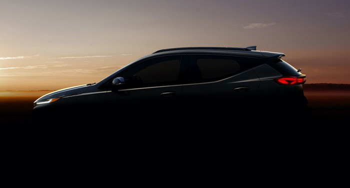 """A """"teaser"""" photo of the upcoming Chevrolet Bolt-based crossover SUV, shown in shadow."""