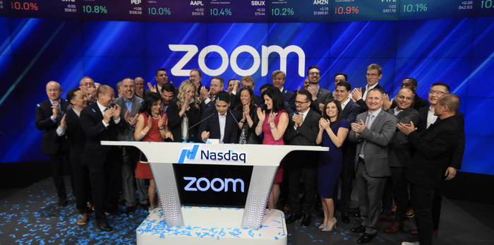 Eric Yuan at the Nasdaq podium for Zoom's IPO.