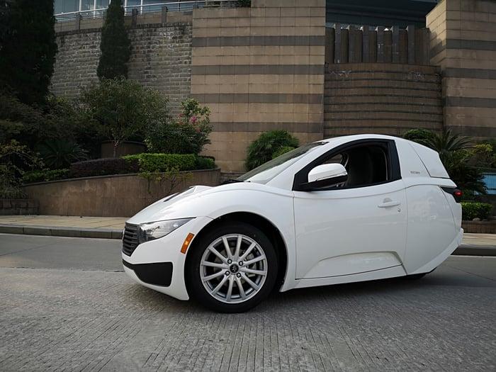 A white ElectraMeccanica Solo, a single-seat three-wheel car
