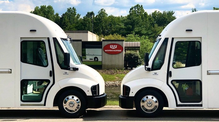 Two Workhorse vans parked in front of the company's headquarters.
