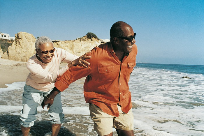 Senior couple having fun  on the beach.