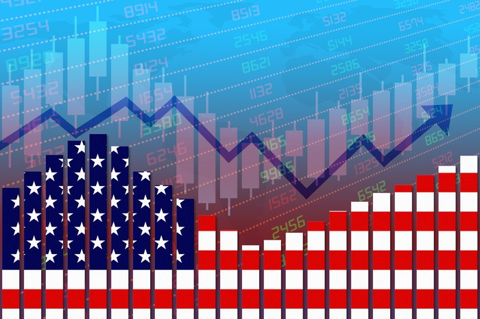 A symbolic stock market chart of the COVID-19 trough and rebound with the chart made up of elements of the U.S. flag.