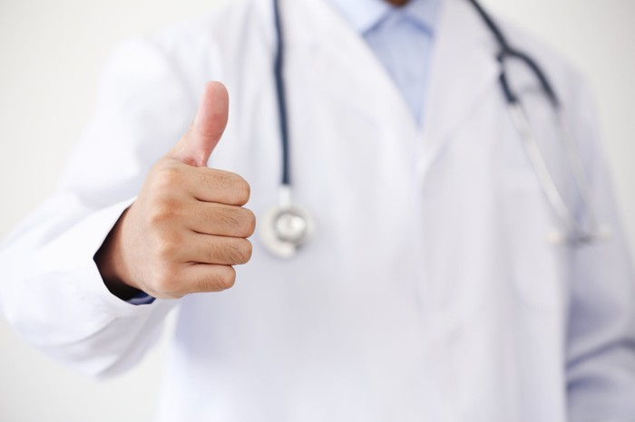 Doctor giving a thumbs up.