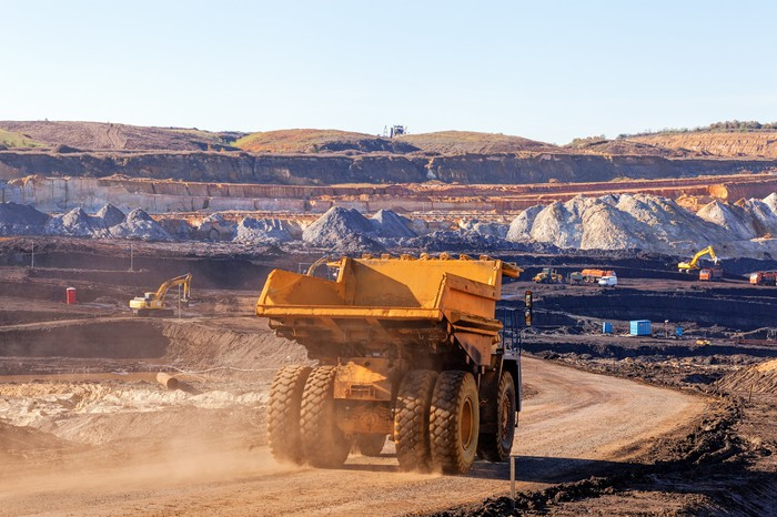 A dump truck on a dirt road at a mining site