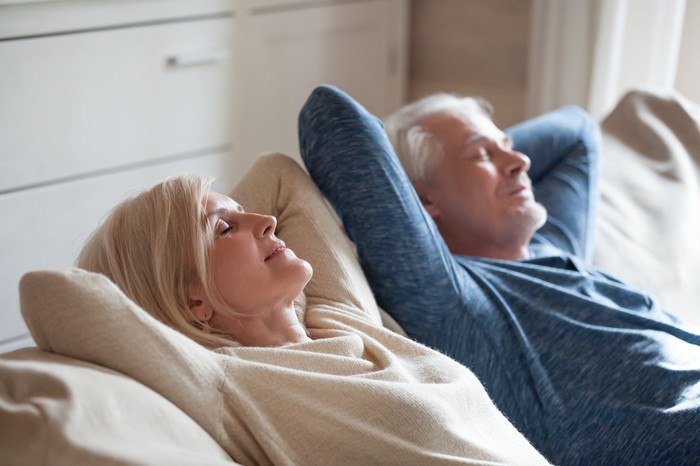 Older couple napping on couch
