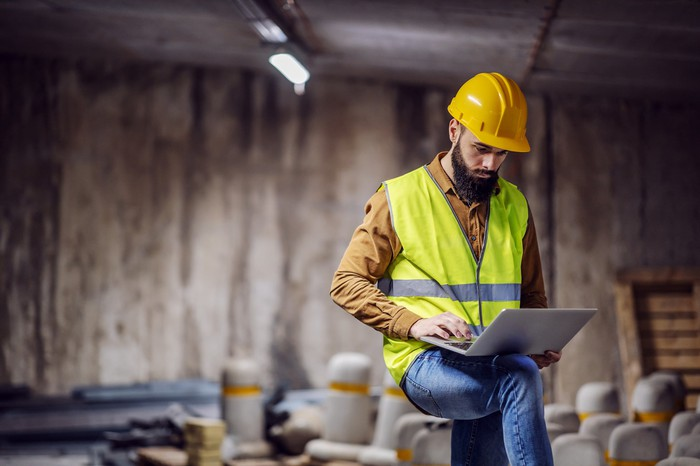 Construction worker using a laptop