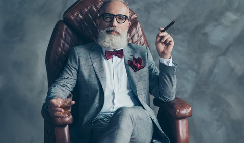 Getty - rich man with cigar wealthy millionaire success style