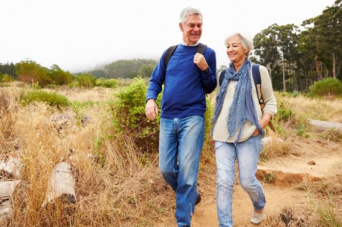 Older man and woman walking outdoors