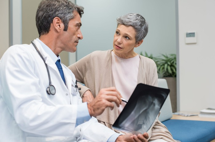 Doctor showing scan to older woman