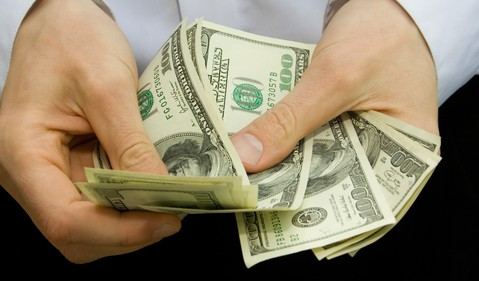 Counting Cash in Hands Money Bills Dividend Invest Getty