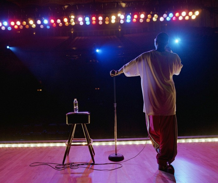 Person standing on stage