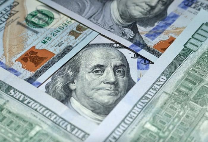 Set of $100 bills arranged in a pattern.