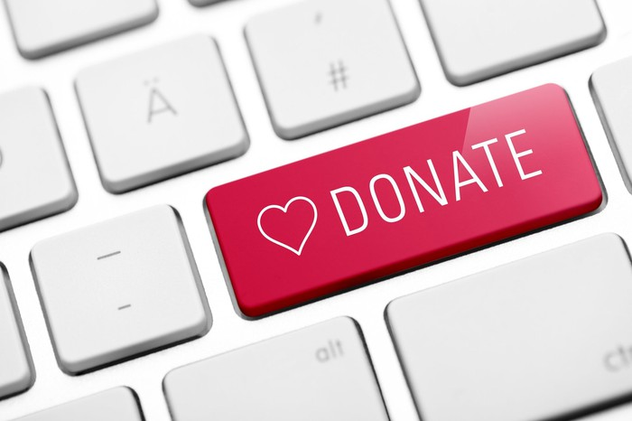 A red key on a keyboard labeled DONATE with a heart beside it.