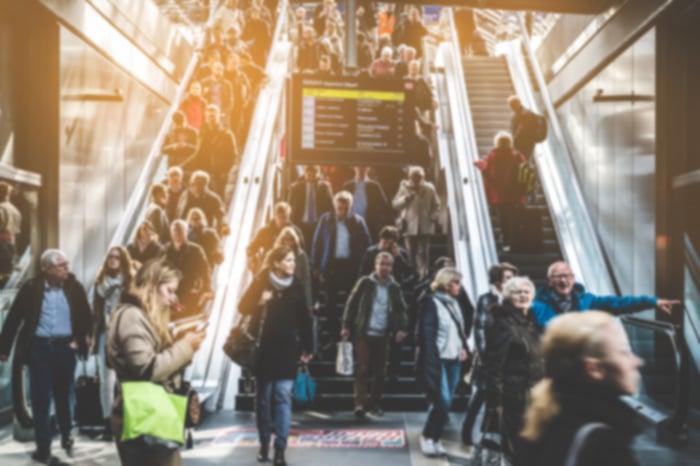 People on a crowded escalator.
