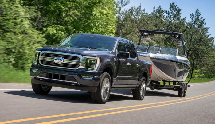 A 2021 Ford F-150 pickup truck, shown towing a boat trailer.