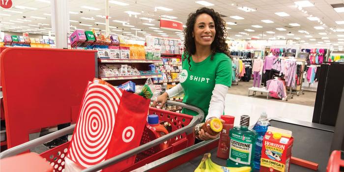 A Shipt shopper pushing her cart in a Target store.