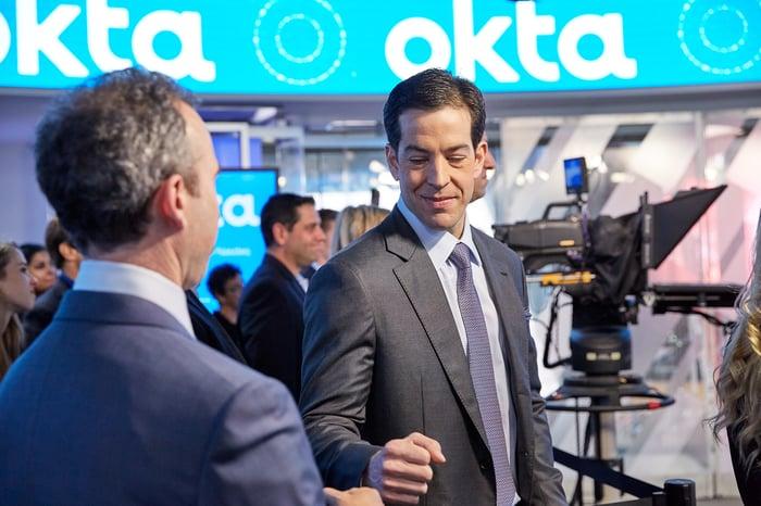 Okta CEO Todd McKinnon gives a fist bump to COO Frederic Kerrest