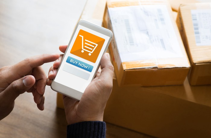 Person using mobile phone to place an e-commerce order