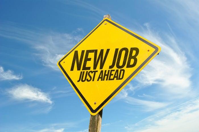 Road sign reading new job ahead.