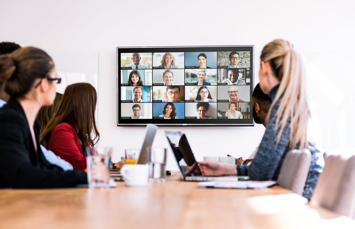 Zoom's video conferencing software being used in a meeting room.