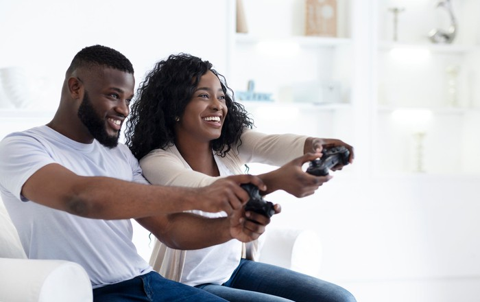 Young couple playing video games together.