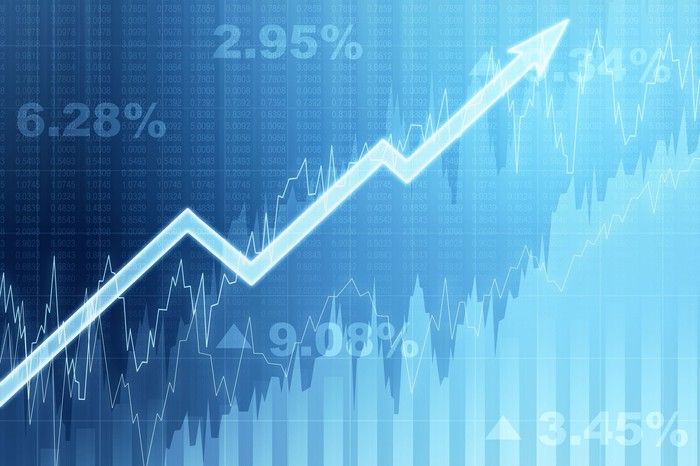 A rising stock arrow against a blue background.