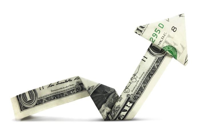 Origami dollar folded into an arrow pointing up.