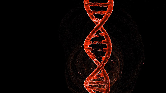 Red DNA double helix with a black background