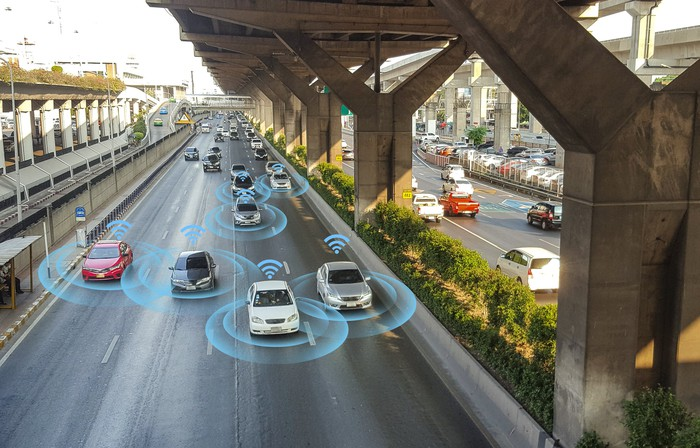 Illustration of self-driving cars on the road together.
