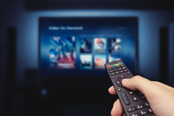 A remote control points at a TV.