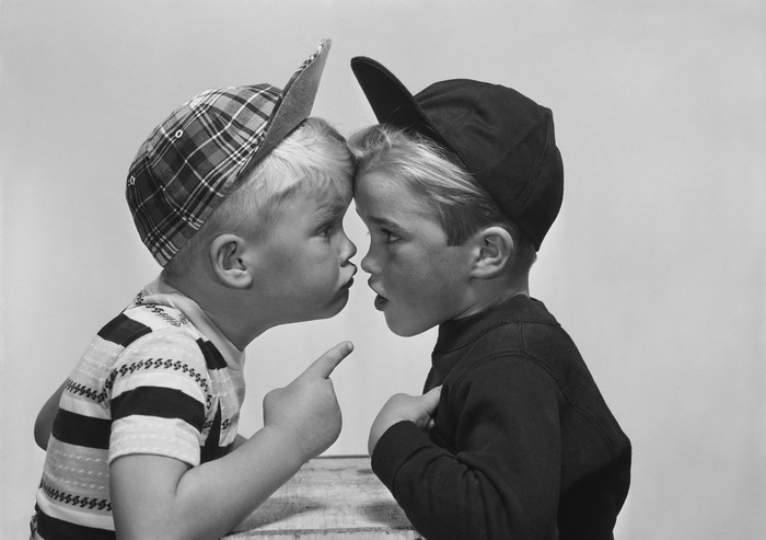 Black and white photograph of two boys in an argument.
