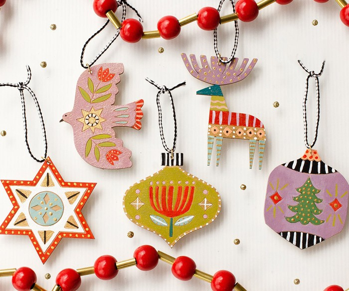 A number of hand-carved holiday ornaments.