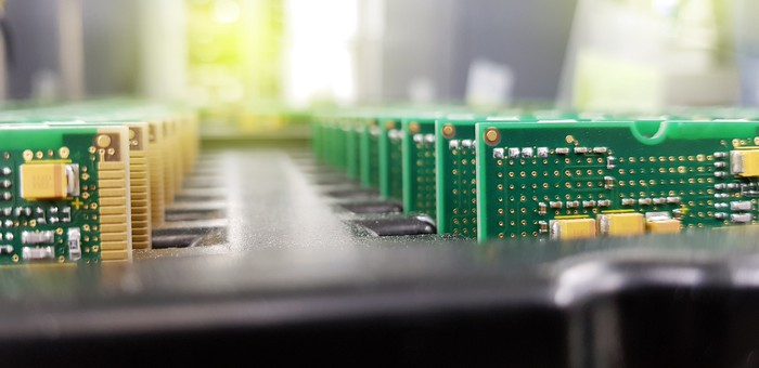 Silicon systems on chips in a rack in a manufacturing plant.