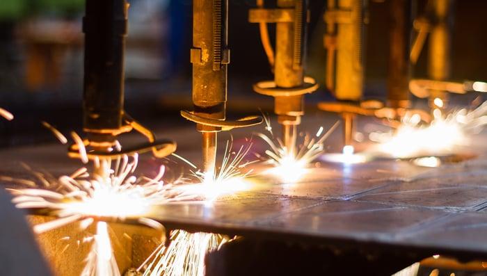 Six fiber lasers make their programmed cuts in a sheet of steel.