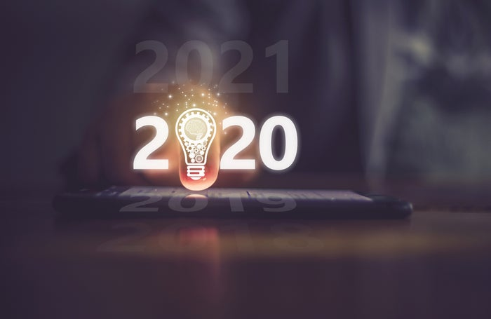Tablet displaying 2020 sign with lightbulb as the first zero in 2020