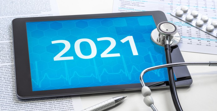 2021 displaying on a tablet with a stethoscope on top of the tablet