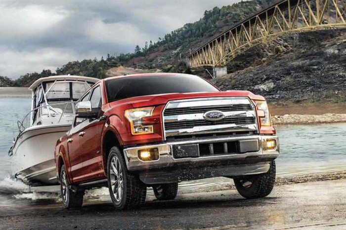 Ford F-150 pickup truck launching a boat