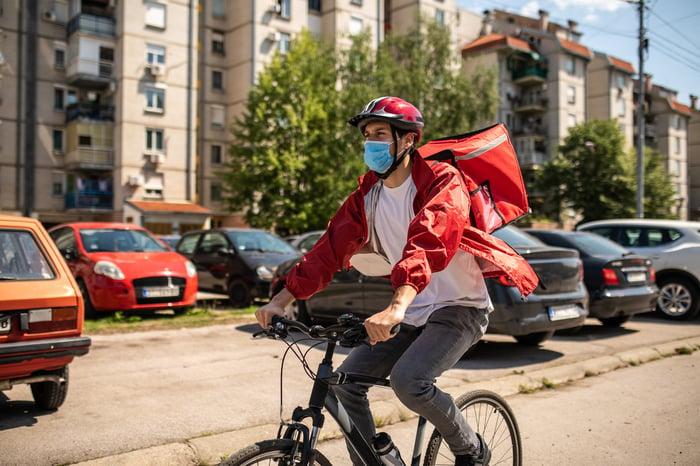 Food courier delivering via bike.