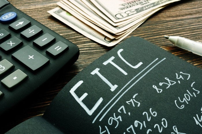 EITC Earned income tax credit calculations on a black notebook page.