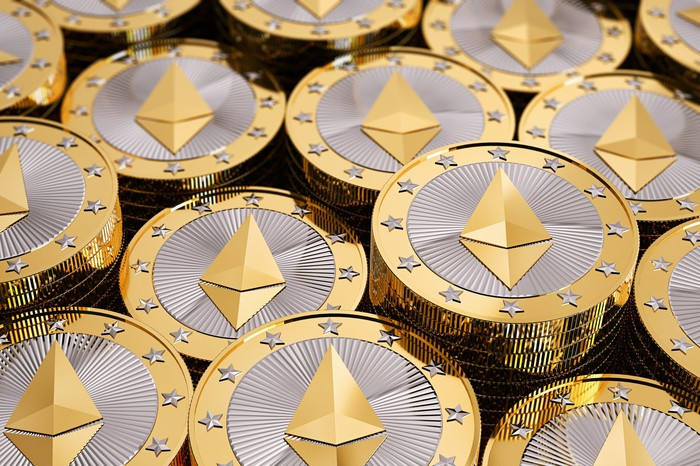 Stacks of physical coins display the Ethereum Blockchain symbol.