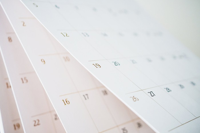Large paper calendar with several months visible