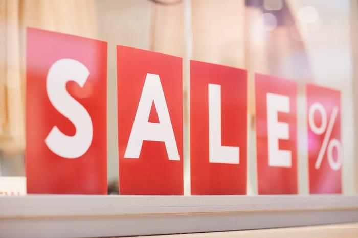 SALE percentage spelled out in blocks in a sales window.