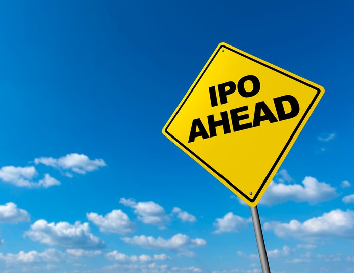A yellow road sign says IPO ahead.