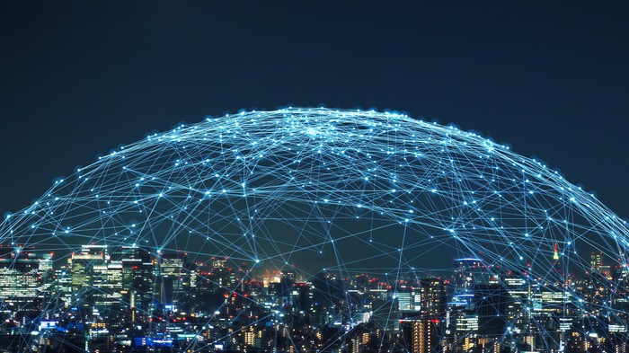 Cityscape with a network of lights superimposed over it