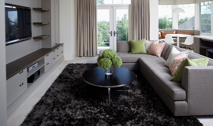 A sectional couch in a living room