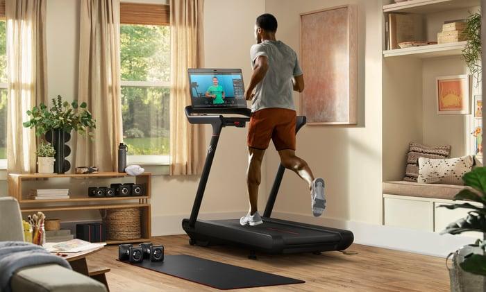 Peloton customer running on a Peloton treadmill.