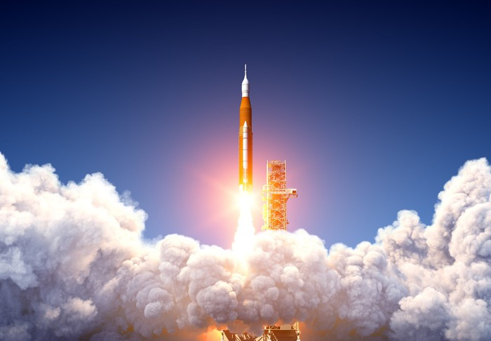 Profile view of a future Space Launch System at liftoff