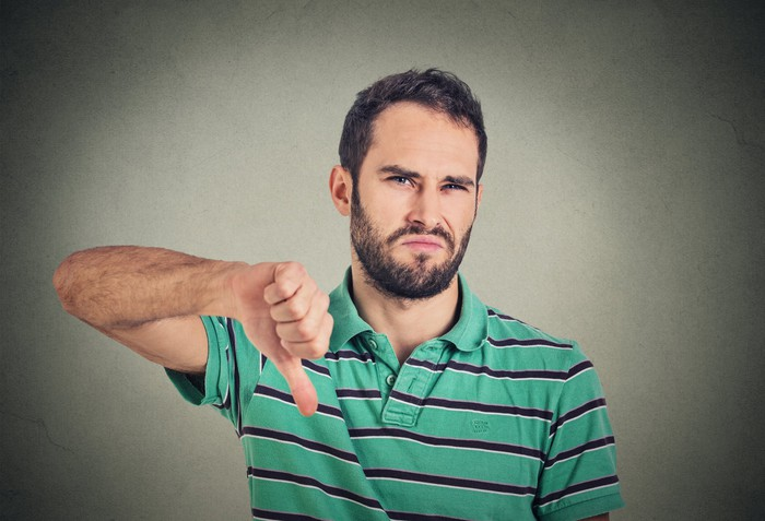 Man making a thumbs down sign
