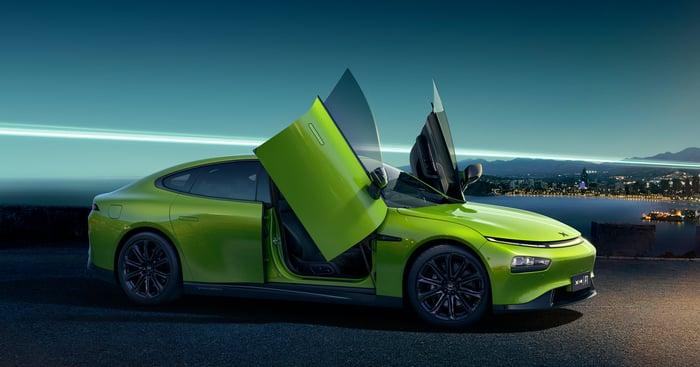 A lime-green Xpeng P7 Wing, a sleek electric sedan.